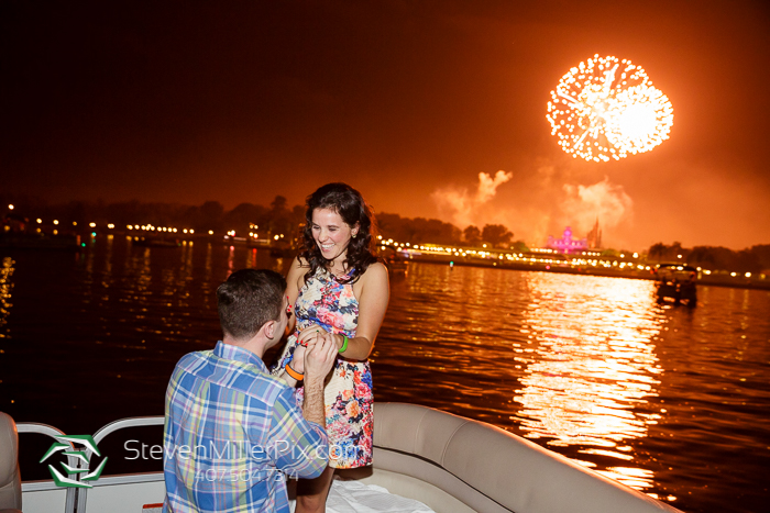 A surprise proposal on a Magic Kingdom Fireworks Cruise. From www.stevenmillerpix.com
