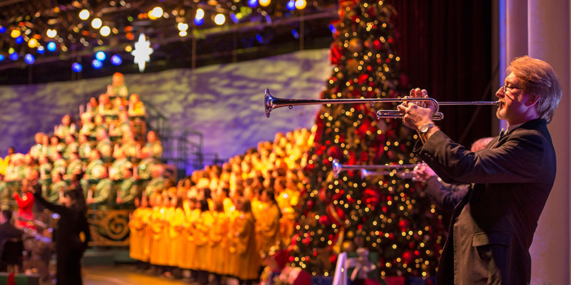 The Candlelight Processional features a joyous retelling of the Christmas story by a celebrity narrator, accompanied by a 50-piece orchestra and a mass choir.