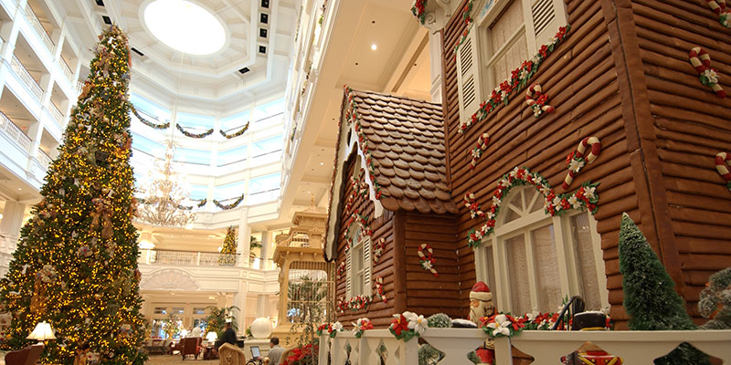 A life-sized holiday gingerbread house is an eye-filling sight in the lobby of Disney's Grand Floridian Resort & Spa.