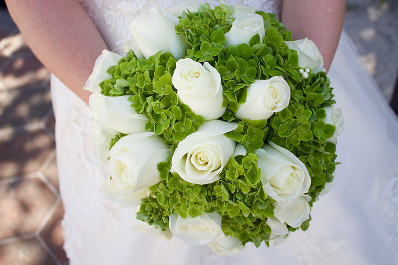 Disney Weddings Flower Option. I choose white roses with green hydrangeas. Note: The hidden Mickey! They also had one on the ribbon that wrapped the flower stems together.