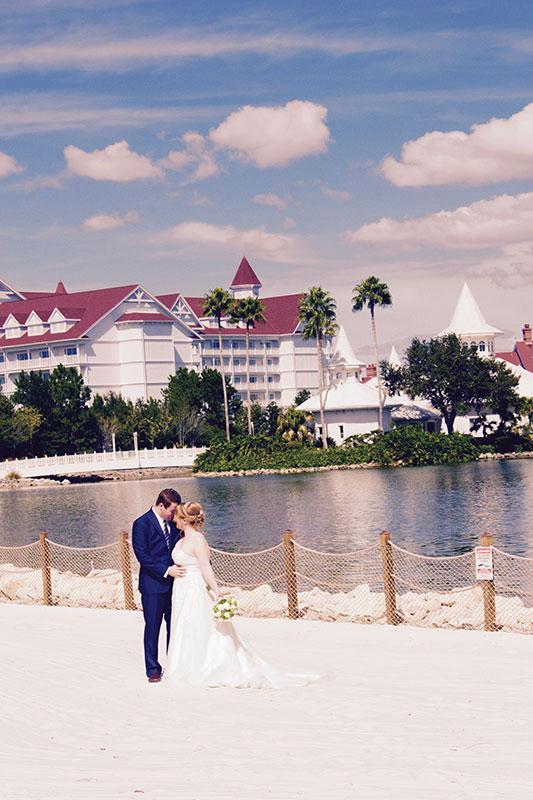 Glamor wedding shot with the Disney Wedding Pavillion in the background.
