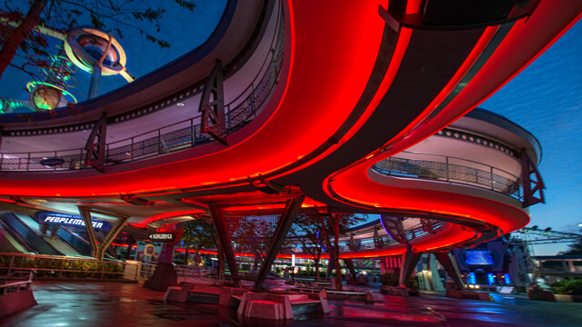 Zip through the skyways of Tomorrowland! I just love catching the views of the castle while riding this attraction at night. Copyright Disney.