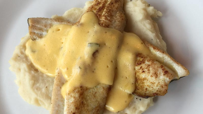 Rainbow trout catch of the day covered with a bernaise sauce.
