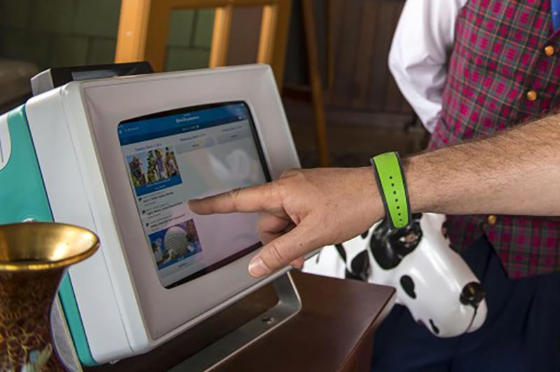 You can use your MagicBand to book Fastpasses in the park or to redeem Fastpasses at attractions. Copyright Disney.