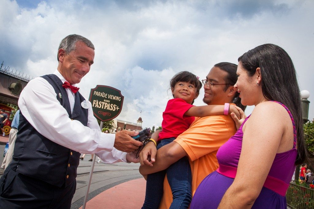 Guests having their MagicBands scanned to redeem their Fastpass experience. Copyright Disney.