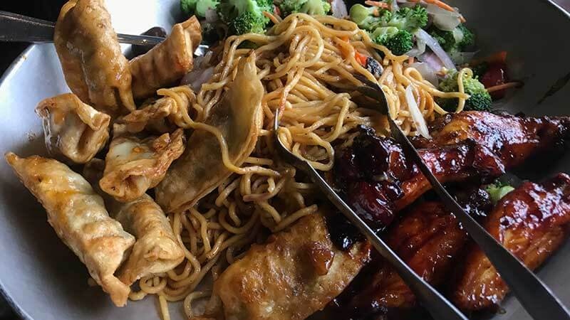 Ohana Appetizer comes out with Chicken Wings, Pork Dumplings, Noodles and Veggies.
