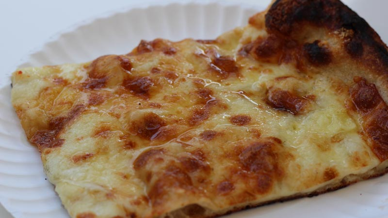 Four Cheese Slice of Pizza
