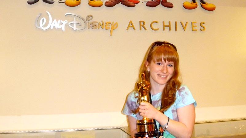 Adventures by Disney holding an Oscar Walt Disney Archives