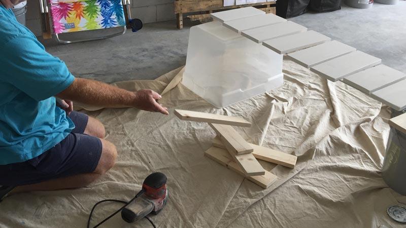 Sanding wood boards for sings