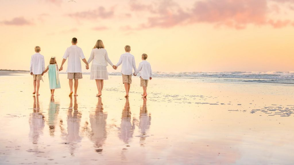 Sunset family walking on the beach